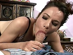 Smoking mature brunette gobbles down a young cock