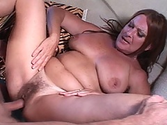 Mature redhead gets her face fucked and a mighty load dumped on it