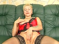 Rough tattooed grandma in cocksucking scenes