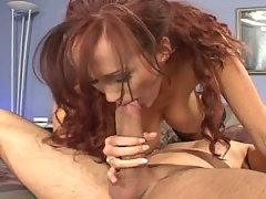 Mature redhead sucks a thick pole of meat