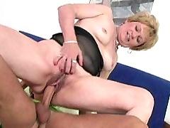 Blonde granny testing a dildo