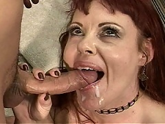 Mature redhead gets her face filled with a sticky load