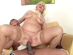 Pretty mom sits on young cock