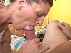 Older brunette sucks down a thick cock pole
