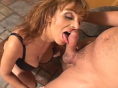Brunette mom sucks on this young studs cock