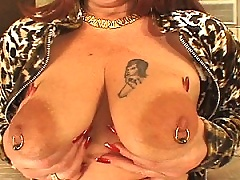 Mature redhead with huge tits takes on a massive stick